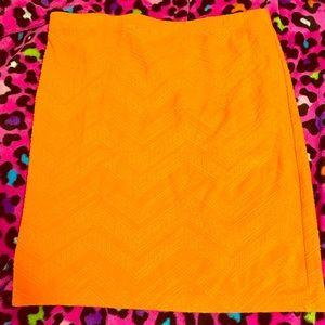 A Bright Orange Mini Skirt